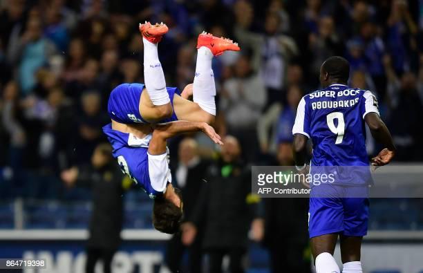 TOPSHOT Porto's Brazilian defender Felipe celebrates next to Cameroonian forward Vincent Aboubakar after scoring a goal during the Portuguese league...