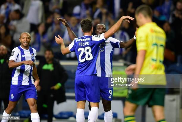 Porto's Brazilian defender Felipe celebrates with Cameroonian forward Vincent Aboubakar after scoring a goal during the Portuguese league football...