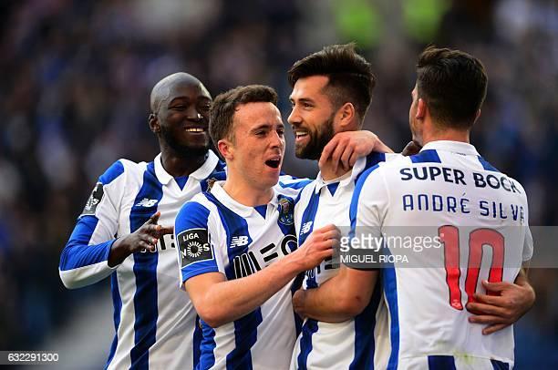 Porto's Brazilian defender Felipe celebrates with teammates midfielder Danilo Pereira forward Diogo Jota and midfielder Andre Silva after scoring...