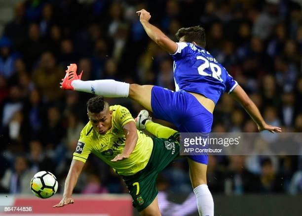 Porto's Brazilian defender Felipe challenges Pacos de Ferreira's Brazilian forward Welthon Sampaio during the Portuguese league football match FC...