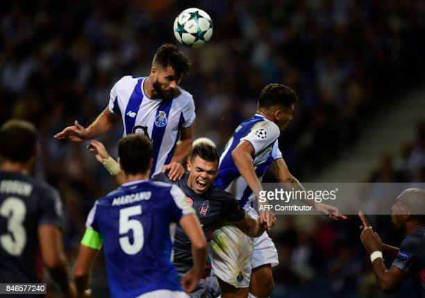 Porto's Brazilian defender Felipe heads the ball next to Besiktas' Portuguese defender Pepe during the UEFA Champions League football match FC Porto...