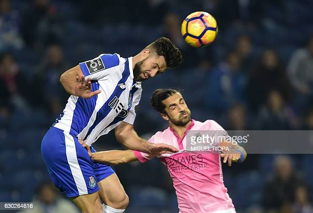 Porto's Brazilian defender Felipe heads the ball with Chaves' defender Nelson Lenho during the Portuguese league football match FC Porto vs GD Chaves...