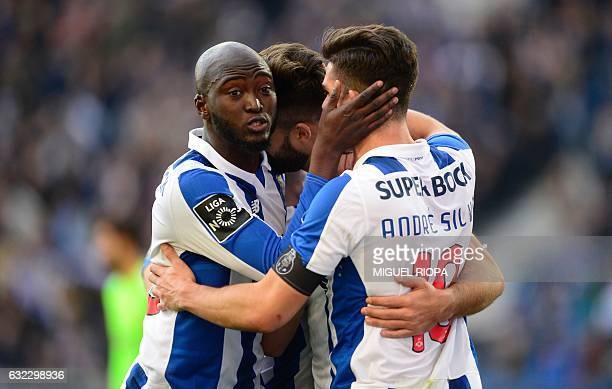 Porto's Brazilian defender Felipe is congratulated by teammates midfielder Andre Silva and midfielder Danilo Pereira after scoring the opening goal...