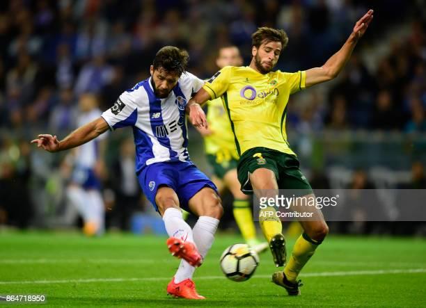 Porto's Brazilian defender Felipe kicks the ball next to Pacos de Ferreira's defender Rui Correia to score a goal during the Portuguese league...