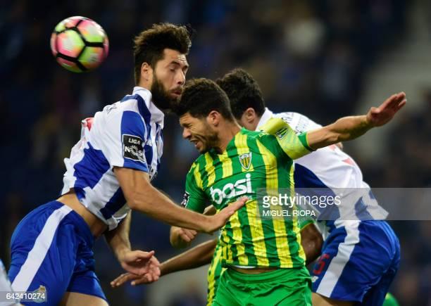 Porto's Brazilian defender Felipe tries to head the ball with Tondela's Brazilian defender Kaka during the Portuguese league football match FC Porto...