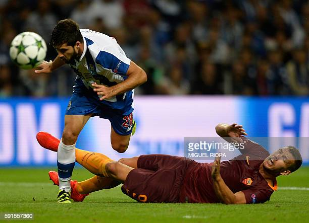 Porto's Brazilian defender Felipe vies with AS Roma's Bosnian forward Edin Dzeko during the UEFA Champions League first leg play off football match...