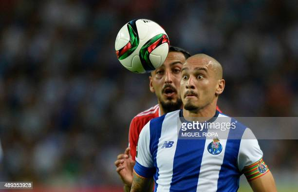 Porto's Brazilian defender Maicon vies with Benfica's Greek forward Konstantinos Mitroglou during the Portuguese league football match FC Porto vs SL...