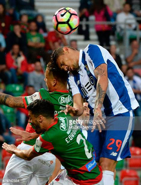 Porto's Brazilian forward Francisco Soares vies with Maritimo's defender Pedro Coronas and German defender Patrick Bauer during the Portuguese league...