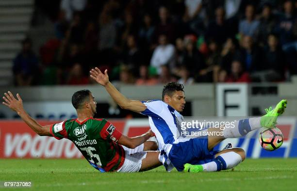 Porto's Brazilian forward Francisco Soares vies with Maritimo's Brazilian midfielder Fransergio during the Portuguese league football match CS...