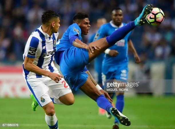 Porto's Brazilian forward Soares vies with Feirense's Brazilian defender Flavio Ramos during the Portuguese league football match FC Porto vs CD...