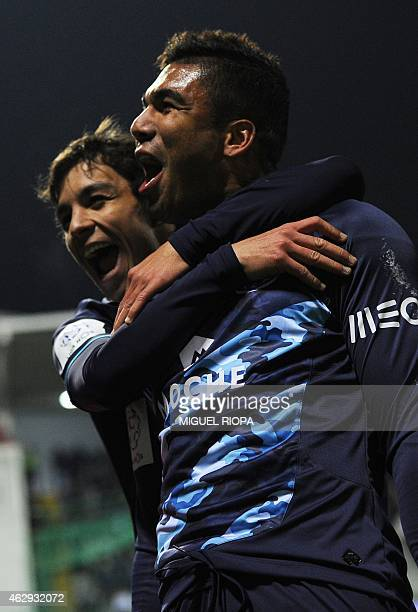 Porto's Brazilian midfielder Casemiro celebrates with Spanish midfielder Oliver Torres after scoring a goal during the Portuguese league football...