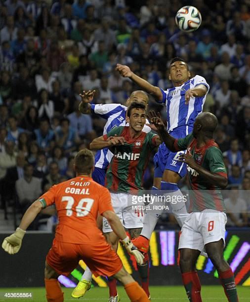 Porto's Brazilian midfielder Casemiro heads the ball next to Maritimo's midfielder Danilo Pereira during the Portuguese league football match FC...