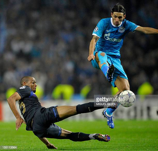 FC Porto's Brazilian midfielder Fernando Reges vies with Zenit St Petersburg's Portuguese forward Danny during their UEFA Champions League Group G...