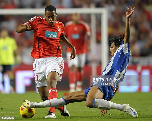 FC Porto's Bruno Alves vies with SL Benfica's Brazilian Sidnei Junior during their Portuguese First league football match at the Luz Stadium in...