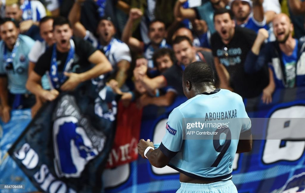 Porto's Cameroonian forward Aboubakar celebrates after scoring a goal during the UEFA Champions League Group G football match AS Monaco FC vs FC Porto on September 26, 2017 at the Louis II stadium in Monaco. / AFP PHOTO / Anne-Christine POUJOULAT