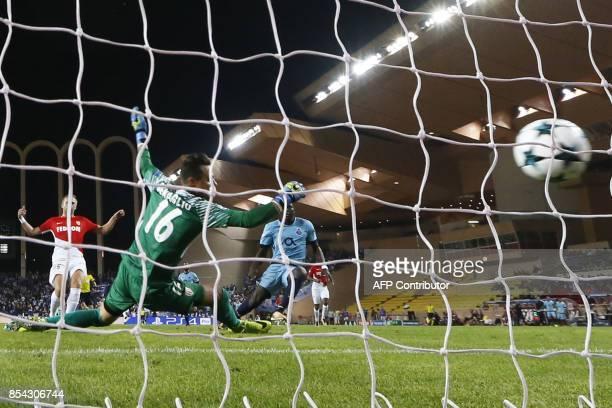 Porto's Cameroonian forward Aboubakar scores a goal during the UEFA Champions eague Group G football match AS Monaco FC vs FC Porto on September 26...
