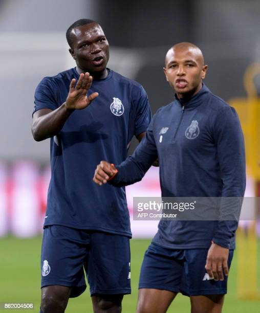 Porto's Cameroonian forward Vincent Aboubakar and Algerian midfielder Yacine Brahimi attend a training session on the eve of the UEFA Champions...