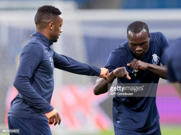 Porto's Cameroonian forward Vincent Aboubakar and Portuguese midfielder Hernani attend a training session on the eve of the UEFA Champions League...