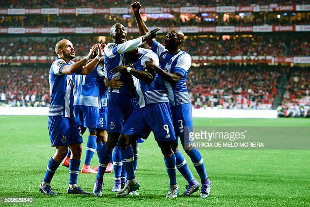 Porto's Cameroonian forward Vincent Aboubakar celebrates a goal with teammates during the Portuguese league football match SL Benfica vs FC Porto at...