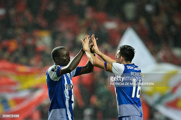 Porto's Cameroonian forward Vincent Aboubakar celebrates a goal with teammate Porto's Mexican midfielder Hector Herrera during the Portuguese league...