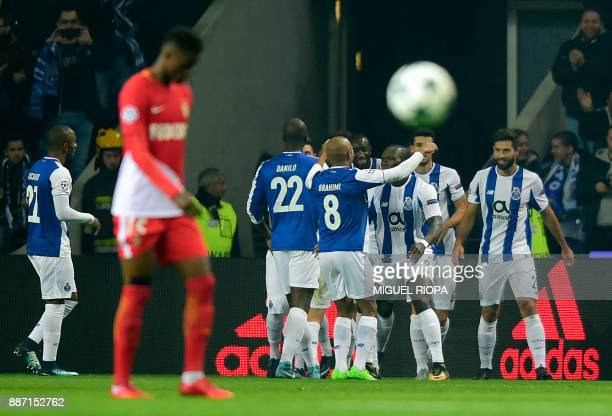 Porto's Cameroonian forward Vincent Aboubakar celebrates a goal with teammates during the UEFA Champions League group G football match FC Porto vs AS...