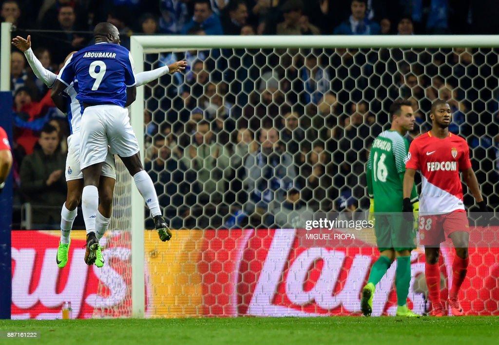 Porto's Cameroonian forward Vincent Aboubakar celebrates a goal with Porto's Algerian forward Yacine Brahimi during the UEFA Champions League group G football match FC Porto vs AS Monaco FC at the Dragao stadium in Porto on December 6, 2017. /