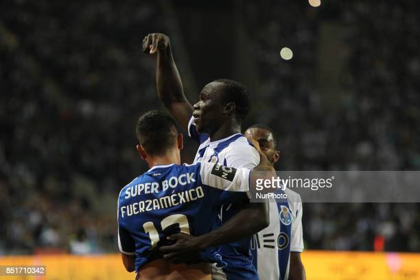 Porto's Cameroonian forward Vincent Aboubakar celebrates after scoring goal with teammate Porto's Mexican forward Jesus Corona during the Premier...
