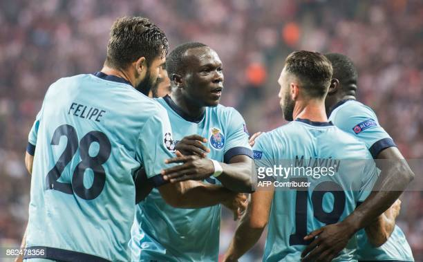 Porto´s Cameroonian forward Vincent Aboubakar celebrates scoring celebrates with his teammates during the UEFA Champions League group G football...