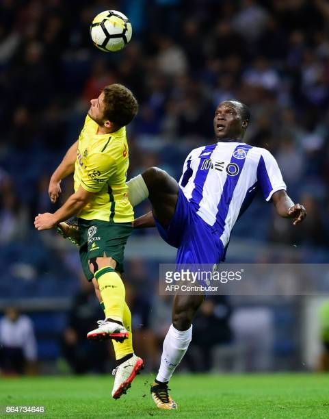 Porto's Cameroonian forward Vincent Aboubakar challenges Pacos de Ferreira's forward Pedrinho during the Portuguese league football match FC Porto vs...