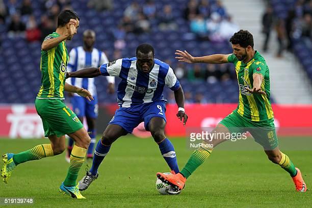 Porto's Cameroonian forward Vincent Aboubakar in action with CD Tondela's Portuguese defender Nuno Santos and CD Tondela's Brazilian defender Kaká...