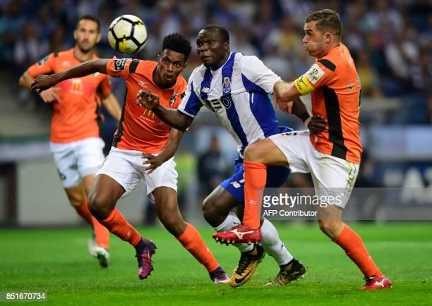 Porto's Cameroonian forward Vincent Aboubakar vies with Portimonense's Brazilian defender Felipe Macedo and defender Ricardo Pessoa during the...