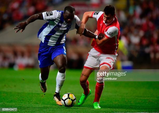 Porto's Cameroonian forward Vincent Aboubakar vies with Sporting Braga's Serbian defender Lazar Rosic during the Portuguese league football match...