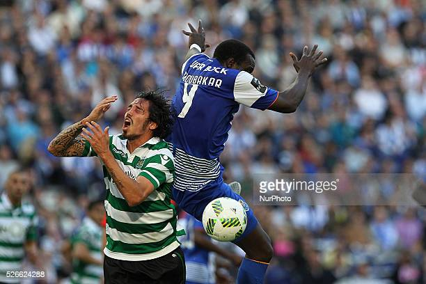 Porto's Cameroonian forward Vincent Aboubakar vies with Sporting's defender Schelotto during the Premier League 2015/16 match between FC Porto and...