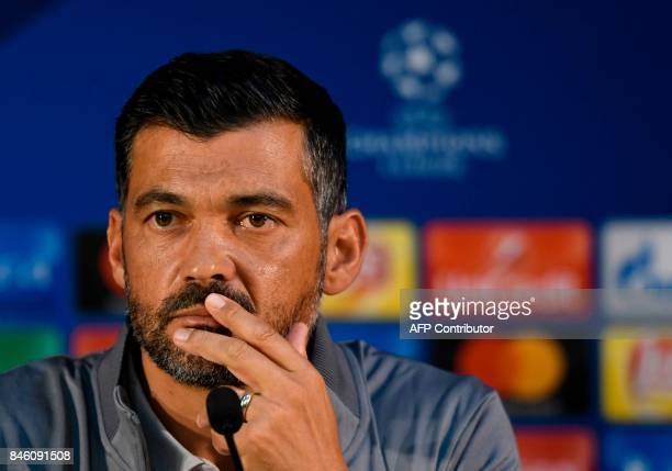 Porto's coach from Portugal Sergio Conceicao looks on during a press conference at the Dragao stadium in Porto on September 12 2017 on the eve of the...