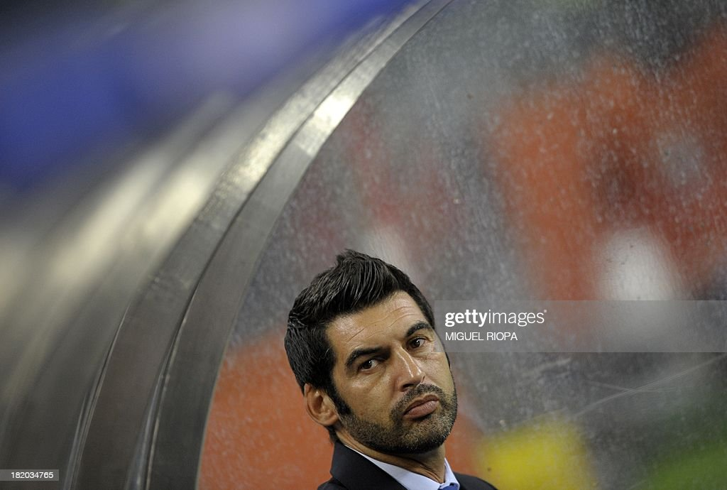 Porto's coach Paulo Fonseca looks on from the bench before the Portuguese league football match Porto vs Vitoria Guimaraes at the Dragao stadium in Porto on September 27, 2013. Porto won the match 1-0. AFP PHOTO / MIGUEL RIOPA