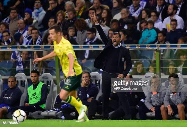 Porto's coach Sergio Conceicao reacts during the Portuguese league football match FC Porto vs FC Pacos de Ferreira at the Dragao stadium in Porto on...