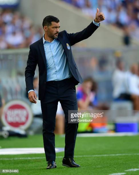 Porto's coach Sergio Conceicao thumbs up to players from the sideline during the Portuguese league football match FC Porto vs Estoril Praia at Dragao...