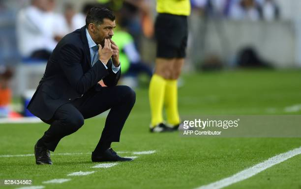 Porto's coach Sergio Conceicao whistles from the sideline during the Portuguese league football match FC Porto vs Estoril Praia at Dragao stadium in...