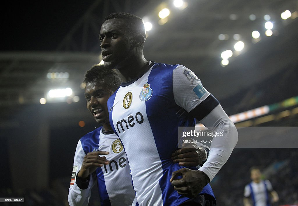 Porto's Colombian forward Jackon Martinez (R) celebrates with teammate Brazilian midfielder Kelvin after scoring a goal during the Portuguese league football match FC Porto vs Moreirense at the Dragao Stadium in Porto on December 8, 2012. AFP PHOTO/ MIGUEL RIOPA