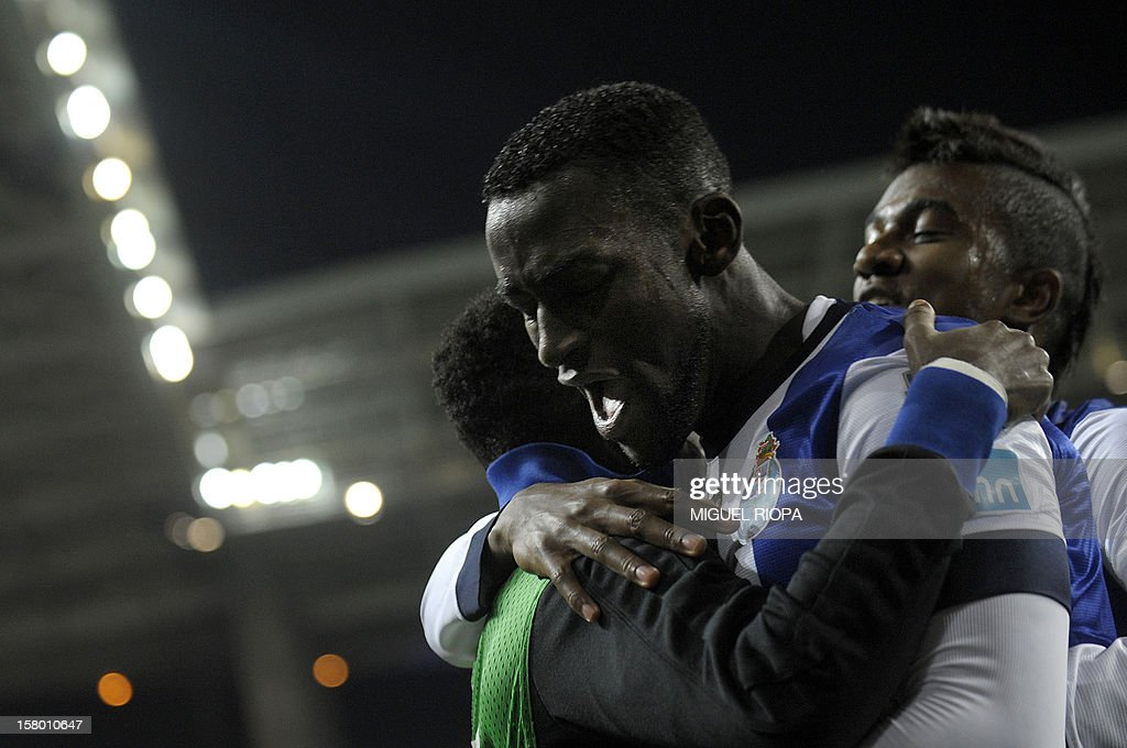 Porto's Colombian forward Jackon Martinez (R) celebrates with teammates after scoring a goal during the Portuguese league football match FC Porto vs Moreirense at the Dragao Stadium in Porto on December 8, 2012.