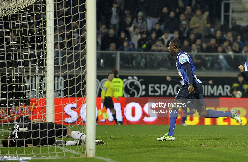 Porto's Colombian forward Jackson Martinez (R) celebrates after scoring a goal during the Portuguese league football match Vitoria SC vs FC Porto at the D.Afonso Henriques Stadium in Guimaraes on February 2, 2013.