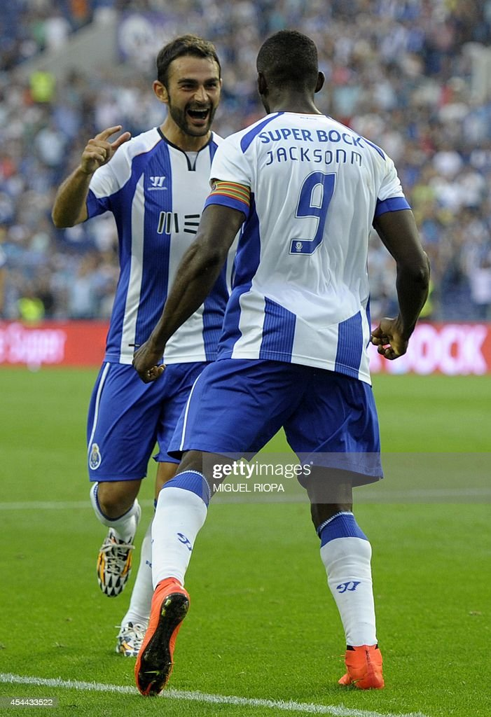 Porto's Colombian forward Jackson Martinez (R) celebrates with teammate Spanish forward Adrian Lopez after scoring his second goal during the Portuguese league football match FC Porto vs Moreirense at the Dragao Stadium in Porto, on August 31, 2014. Porto won the match 3-0.