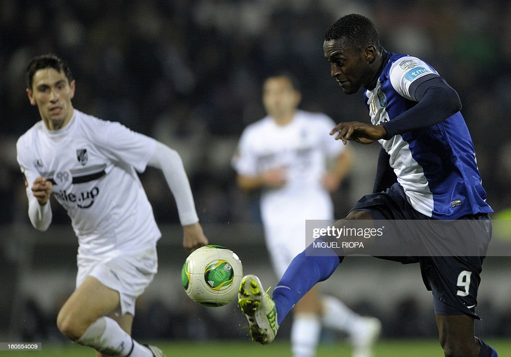 Porto's Colombian forward Jackson Martinez (R) controls the ball during the Portuguese league football match Vitoria SC vs FC Porto at the D. Afonso Henriques Stadium in Guimaraes on February 2, 2013. Porto won the match 4-0 and Colombian forward Jackson Martinez scored a hat-trick.