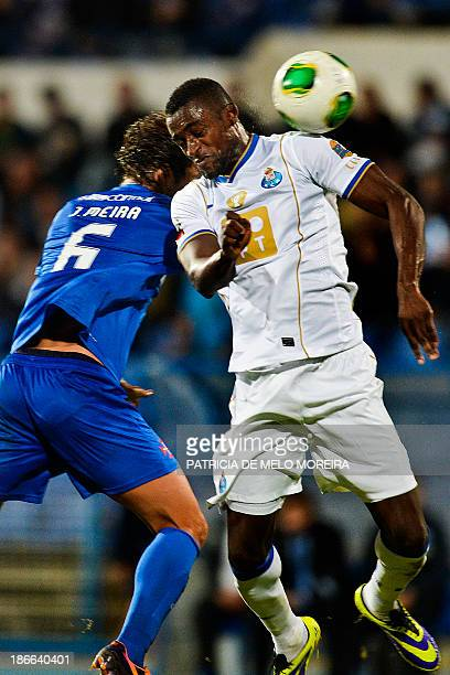FC Porto's Colombian forward Jackson Martinez heads the ball with Belenenses' defender Joao Meira during the Portuguese league football match...