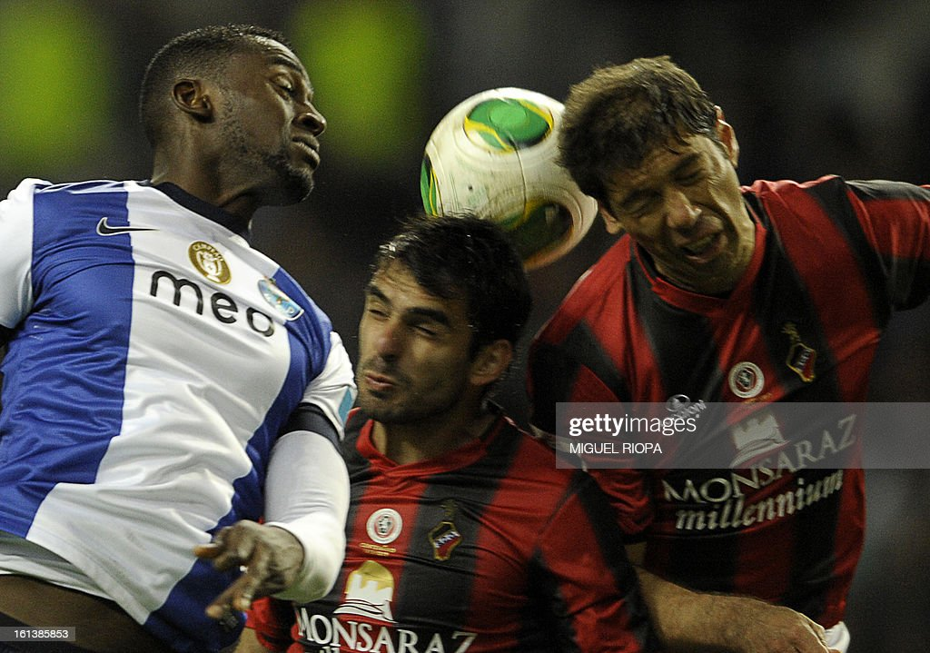 Porto's Colombian forward Jackson Martinez (L) jumps for the ball with Olhanense's Tiago Terroso (C) and Brazilian defender Mauricio (R) during the Portuguese first league football match FC Porto vs Olhanense at the Dragao Stadium in Porto, on February 10, 2013. The match ended in a draw 1-1.