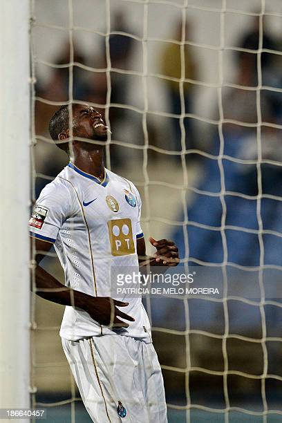 FC Porto's Colombian forward Jackson Martinez reacts after missing a goal opportunity during the Portuguese league football match Belenses vs FC...