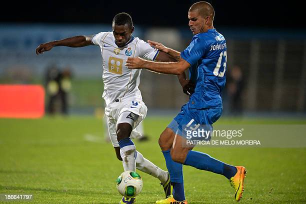 FC Porto's Colombian forward Jackson Martinez vies with Belenenses' defender Joao Afonso during the Portuguese league football match Belenses vs FC...