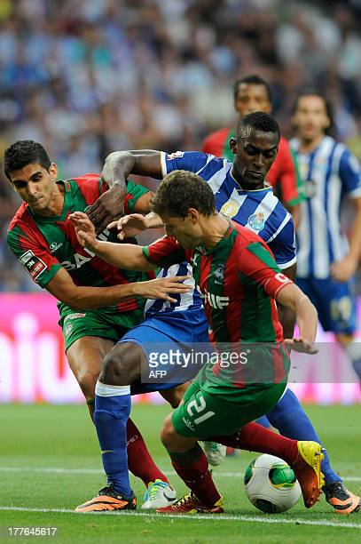 FC Porto's Colombian forward Jackson Martinez vies with Maritimo's Portuguese defender Briguel and Brazilian defender Igor Rossi during the...