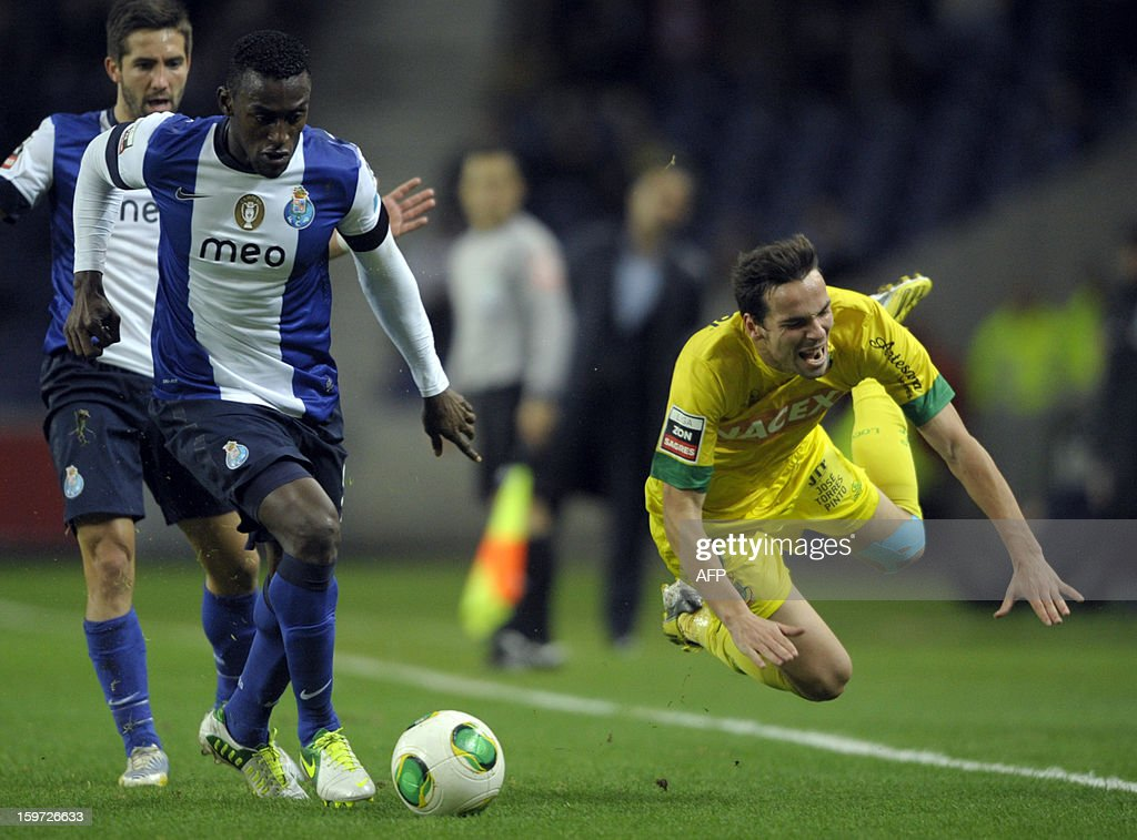 Porto's Colombian forward Jackson Martinez (L) vies with Pacos Ferreira's midfielder Andre Leao during the Portuguese league football match FC Porto vs Pacos Ferreira at the Dragao stadium in Porto on January 19, 2013.
