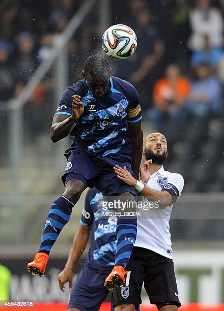 Porto's Colombian forward Jackson Martinez vies with Vitoria SC's midfielder Andre Andre during the Portuguese league football match Vitoria SC vs FC...